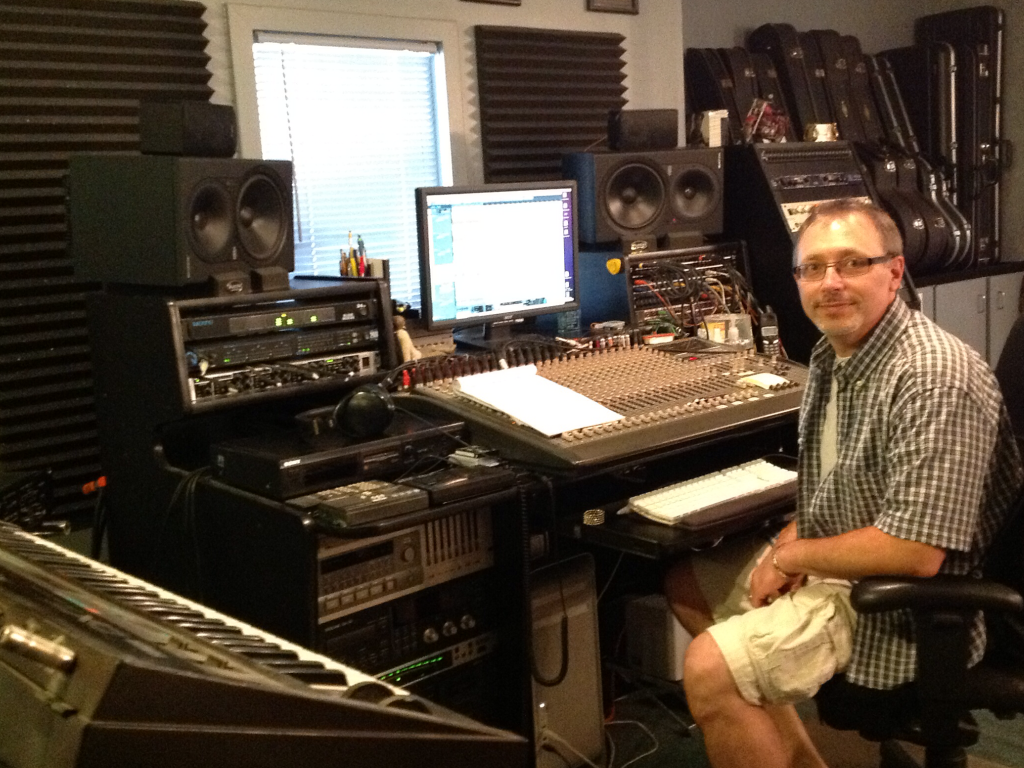 Louis Drapp, recording engineer, sitting in the control room