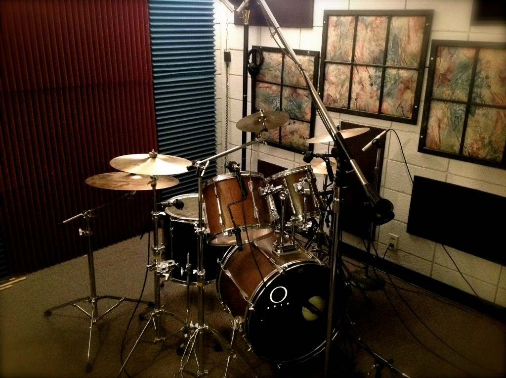drum room with drum set and microphones