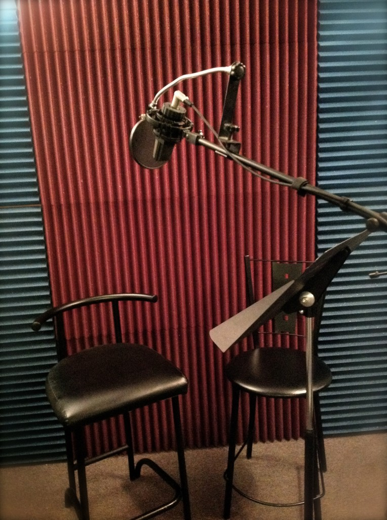 recording room with two chairs and a microphone